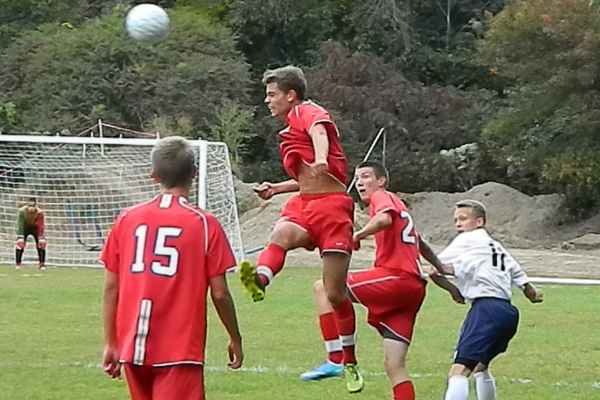 Senior forward Matt Lemos (10) goes high for a header.