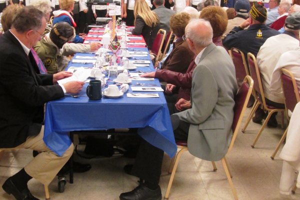 A cake and red, white and blue decorations set the mood at the senior center's Veterans Luncheon.