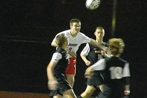 Junior defender Benn Lafortune (9) battles for a header.