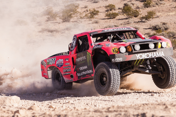 Heidi's hot pink and purple Geiser Brothers custom-built, unlimited Class 6 trophy truck.