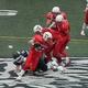 Troy Carey (22) breaks a tackle