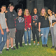 """SCHS Interact Club have their flashlights out for a tour of the """"graveyard""""."""