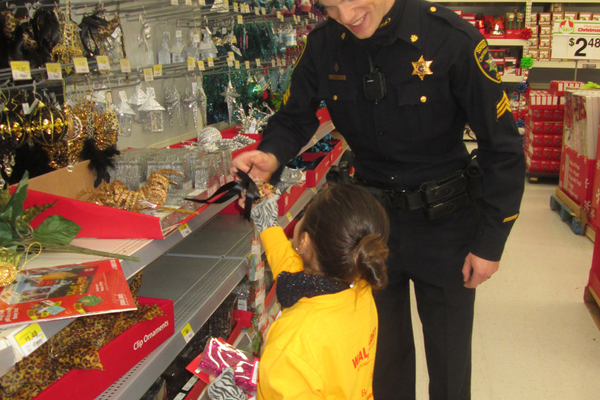 Adam Sibley and Danetzy Araujo pick out holiday ornaments.