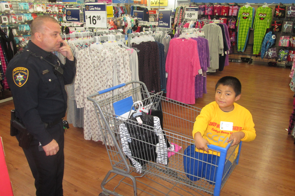 Charles Inga gets some shopping assistance on Saturday morning