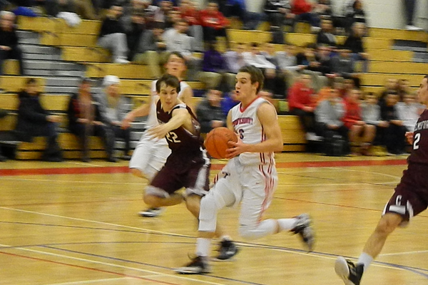 Alex DiRocco (3) beats Chelmsford on the fast break.