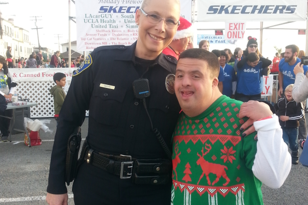 Manhattan Beach Police Officer Stephanie Martin with one of her favorite people, Jacob.