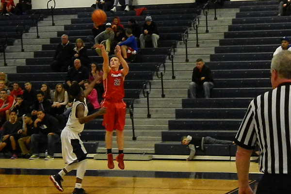 Henry Roberts (21) fires a three-pointer against Lawrence.