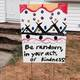 GOOD signs like this one have been placed all over town, challenging neighbors to do good deeds.