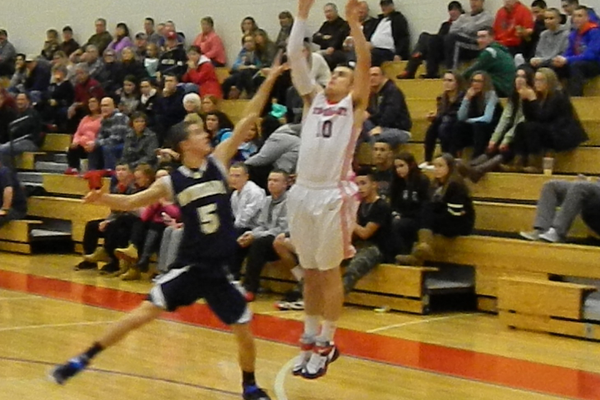 Derek McGaffigan (10) fires off a three-pointer.