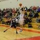 Derek McGaffigan (10) fires off a three-pointer.