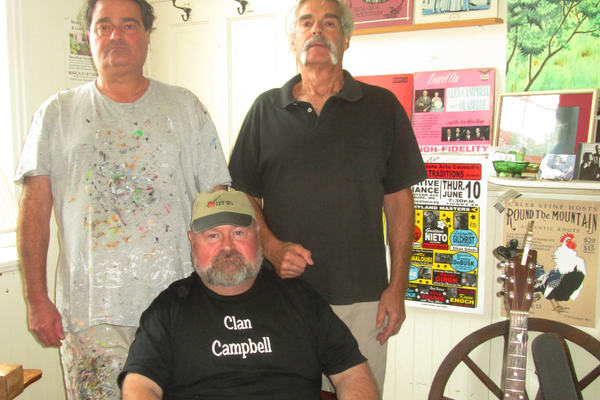 Zane and Hugh Campbell (standing) with their cousin, Jerimy.