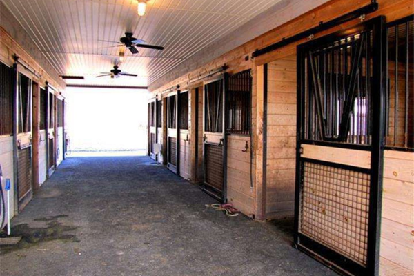 An eight-stall barn provides all of the modern amenities an equestrian needs.