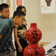 Guests enjoy the Chinese lacquer ware exhibit.