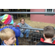 Photo by Richard L. Gaw	Margaret Leardi, Animal Sciences Program teacher at the Centreville School, introduces students to Rhett, a pot-bellied pig at the school's barn.