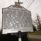 A historical marker documents the history of the site.
