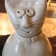 A ceramic cat sculpture.