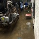 The water in the boiler room at Trahan School was down to about 18 inches, after having reached a crest of four feet due to the water main break.