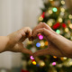 Alexandria and her mother, Tania Lecaros, form a heart in front of the Christmas tree at the Hamilton home of Lecaros' mother.