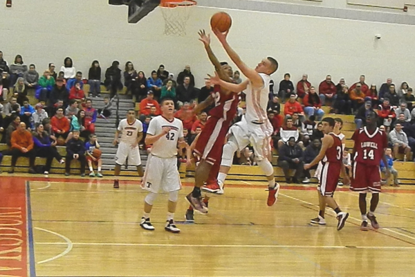 Alex DiRocco (3) scored 11 points against Lowell.