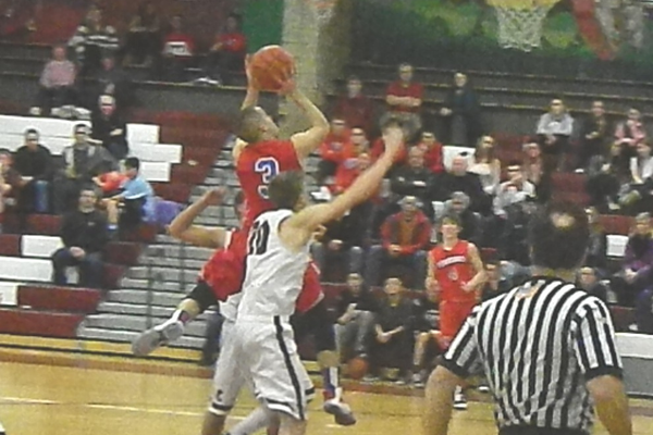 Alex DiRocco flies through the lane for two points.