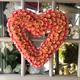 A heart wreath hangs from the door at Growing Wild