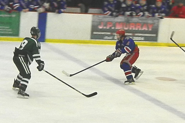 Colin Quinn (2) rushes up ice with the puck.