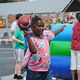 Mari Collick tosses the football at one of the many games at the Peach Festival.