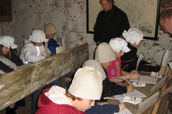 "Courtesy photo As a part of ""School Days,"" students experience an 18th century schoolroom by participating in lessons using quill pens, slates, and chalk."
