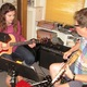 Nicole Ehinger and instructor Jay Scott work out a new song during a guitar lesson in West Chester.