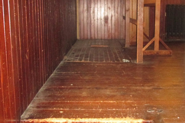 Well-worn steps led up to the stage, and a trap door in the floor led to stairs so actors could come and go from the lower level.
