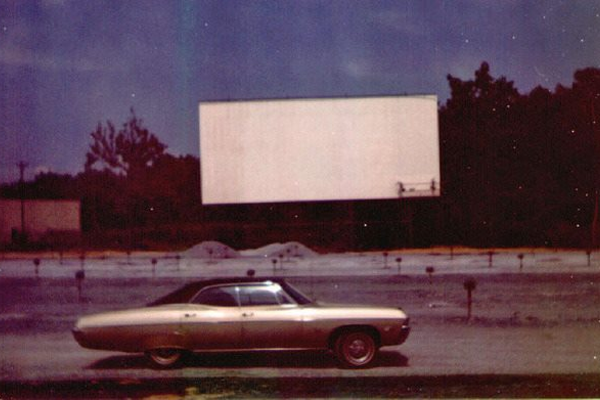 The Newark Drive-In. A crew is re-painting the screen white in the background.