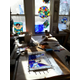 Leathrum's work area illustrates her varied artistic endeavors.