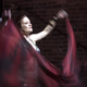 Belly Dancer Claire Metz mesmerizes the audience with her grace, beauty and style as part of the Sidecar Symposium circus full of performances. She and the rest of the Humaya Tribal Fusion Dance Troupe raised the temperatures in the area by several degrees. Music? Was there music? Who remembers... Photo: Robert Berlin