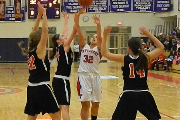 Haley Pozzuto (32) goes up for a shot.