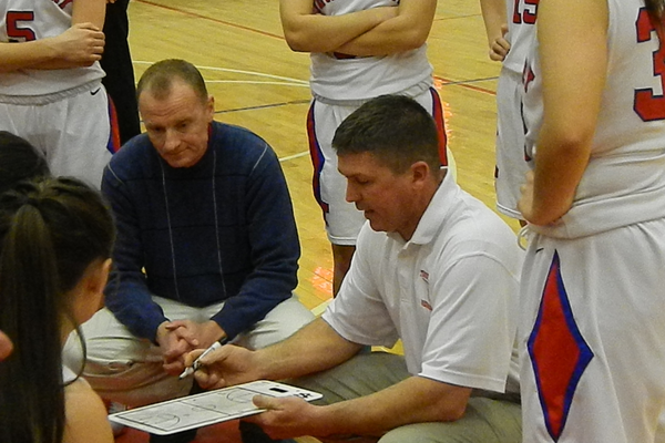 Coach Mark Bradley instructs the team during a time out
