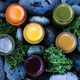 Colorful jars of fresh cold-pressed juices.
