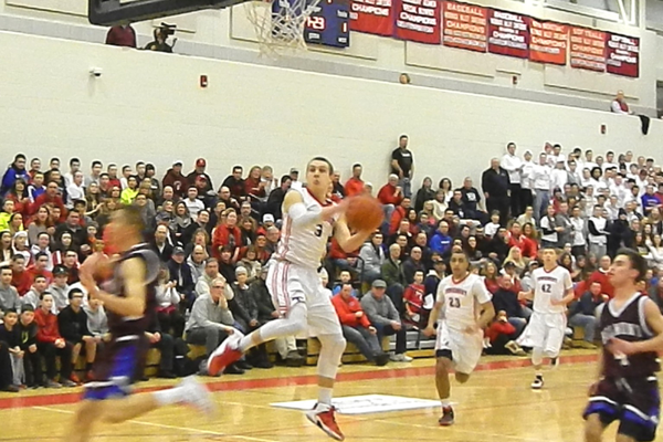 Alex DiRocco (3) drives the lane for two of his 18 points against Belmont.
