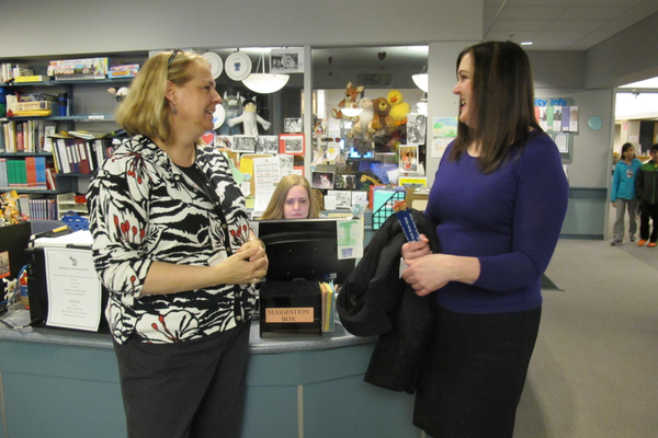 TPL Director Diane Giarrusso speaks with North Street Principal Angela Kimble during the annual North Street Elementary School Night at the Tewksbury Public Library. Rachel Steele, Circulation Supervisor, is in the background.