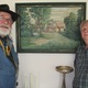 Brundin and his wife Michael, with a painting of the home they shared in Sweden.