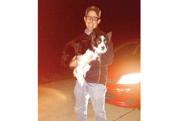 Jake Carpenter is reunited with his family's dog after driving more than 20 hours from Hatch, New Mexico to Oswego Sunday and Monday. (Photo provided by Katherine Manola)