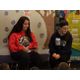 Tewksbury High athletes Megan Donohue and Nikilina Taromino read to students in the 2nd grade class of <rs. Donahue, Mrs. LaFlamme and Mrs. Covino during literacy day at the Dewing School.