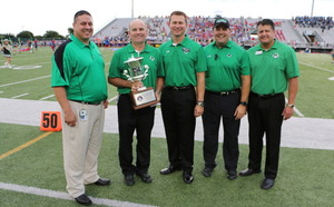 CSHS Principal Shawn Duhon center accepts Southlakes 3rd straight UIL Lone Star Cup during a ceremony before the 2014 football season opener at Dragon Stadium