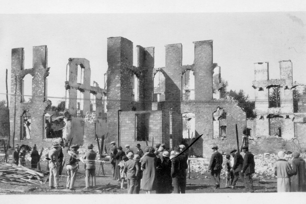 Citizens survey the damage from the 1928 millwork fire.