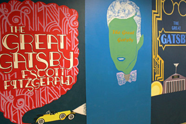 "Among the scenic backdrops created by Painting and Design Technologies students were several giant-sized renditions of ""The Great Gatsby"" covers. Some covers were taken from actual editions of the novel, while others were original creations of BVT students."
