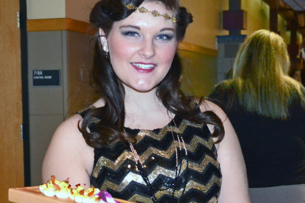 "Culinary Arts senior Mikaela Schwartz of Millbury volunteered to serve food inspired by ""The Great Gatsby."" Photo courtesy of Multimedia Communications senior Jillian Karakeian of Bellingham."