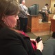 Jayne Miller nervously texts as roll call votes were cast.