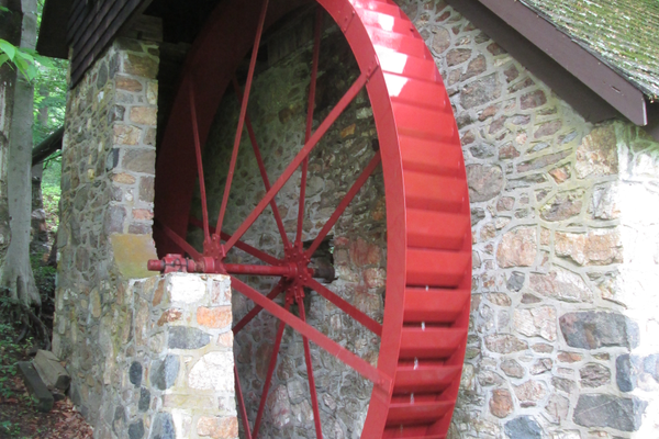 The restored wheel, turning under water power.