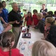 Students and staff from the Williamson Free School of Mechanical Trades present science demonstrations for young visitors.