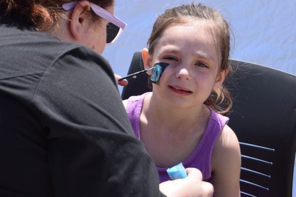 Ella Toohey having her face painted during Rodeo.