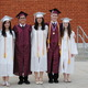 Maddie Sapp Mireya Lopez Jesus Villagomez Braise Alexander Thomas Sumner and Tina Rogers in front of the high school before the graduation ceremony